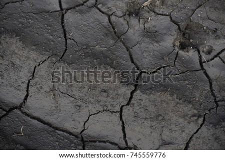 Crack pattern of clay. Asphalt Cracked Road Dark Texture Stock Vector 123459817