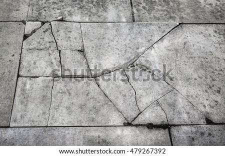Cracked and broken concrete pavement slab