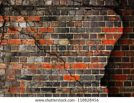 Cracked and damaged brick wall background - stock photo