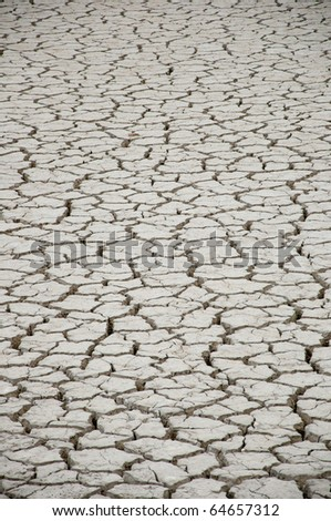 cracked and dry earth in the desert - stock photo