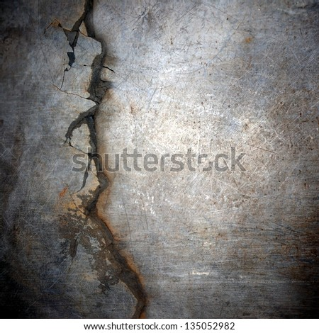 cracked  and scratched metal surface ; abstract grunge background - stock photo