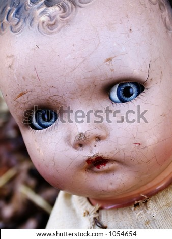 Cracked antique doll face - stock photo