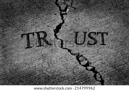 Cracked cement symbolizing broken trust between people or parties - stock photo
