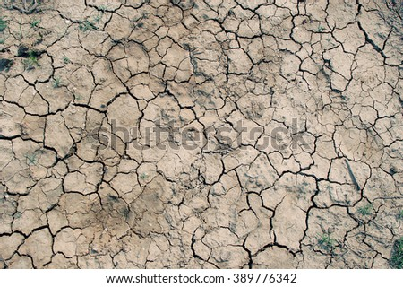 Cracked dry earth (retro style) - stock photo