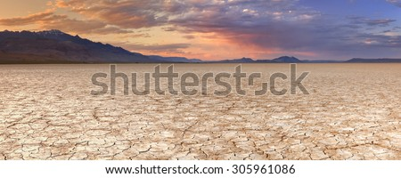 Cracked earth in the Alvord Playa, a dry lakebed in the Alvord Desert in southeastern Oregon, USA. Photographed at sunset. - stock photo