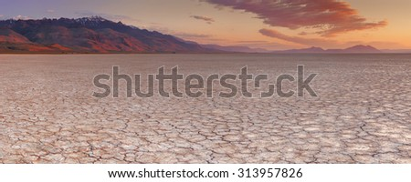 Cracked earth in the Alvord Playa, a dry lakebed in the Alvord Desert in southeastern Oregon, USA. Photographed at sunrise. - stock photo
