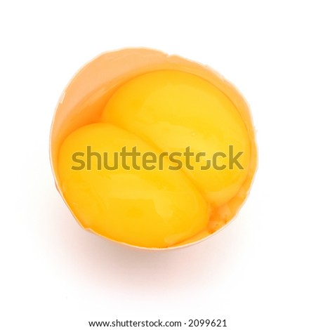 Cracked egg with double yolks - stock photo