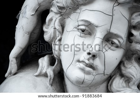 Cracked face of female traditional sculpture at ABAC university, Thailand - stock photo