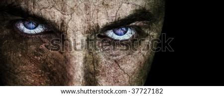 Cracked face with sinister evil scary eyes over black - stock photo
