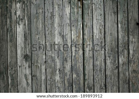 cracked gray wood texture on vintage wall - stock photo
