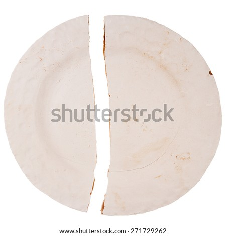 Cracked greenware plate isolated on white background  - stock photo