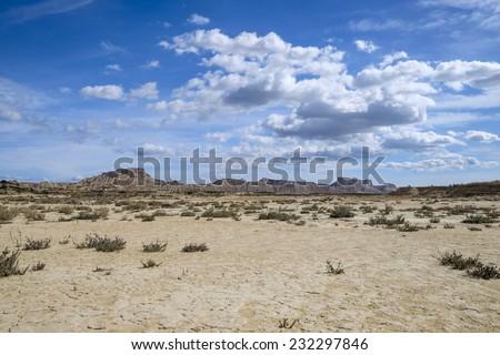 Cracked ground at desert of Bardenas Reales, Navarra, Spain - stock photo