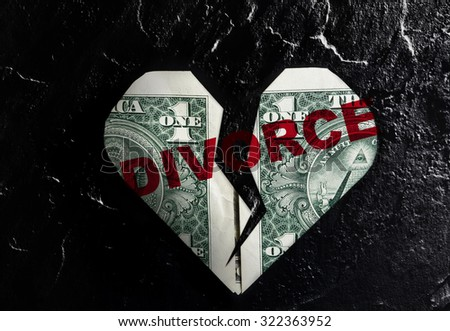 Cracked heart shaped dollar with red Divorce text - stock photo