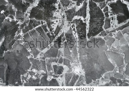 Cracked ice background. Pattern - stock photo