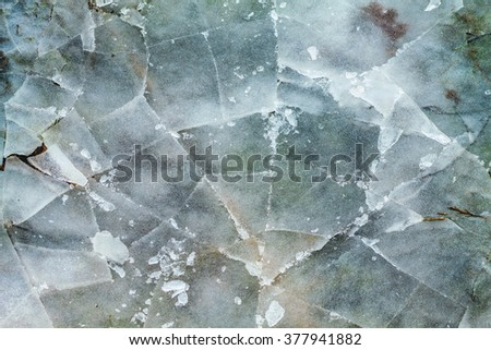 Cracked ice texture. Top view. Nature winter background. - stock photo