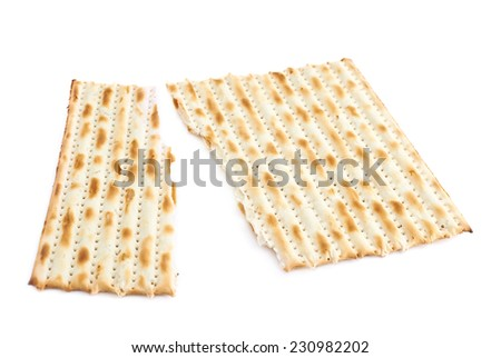 Cracked in two pieces machine made matza flatbread, composition isolated over the white background - stock photo