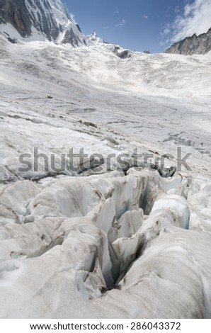 Cracked Leschaux glacier and mountains in the french Alps - stock photo