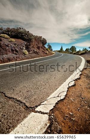Cracked mountain road, Canary Island Tenerife, Spain - stock photo