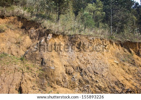 cracked mountain showing red soil - stock photo