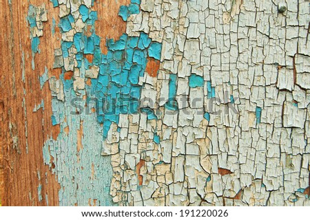 Cracked paint on a wooden wall. Wall from wooden planks with paint traces. old painted wood wall texture, grunge background, cracked paint. Blue and white paint on wood - stock photo