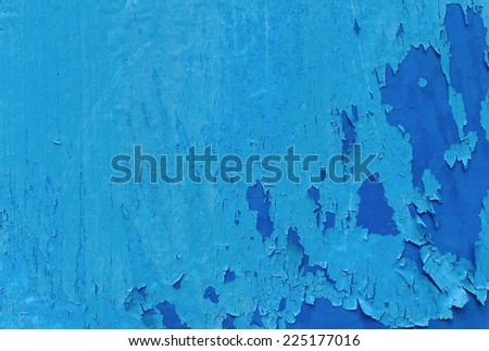 cracked paint pattern on on wall texture, Blue scratch background. - stock photo