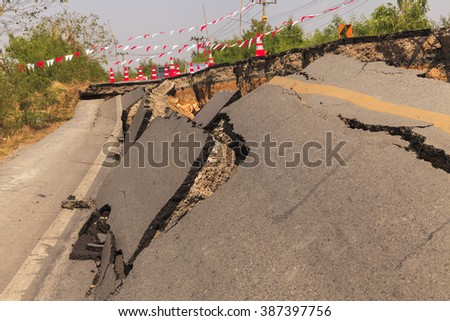 Cracked road after the earthquake - stock photo