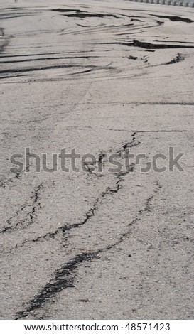 cracked roadway - stock photo
