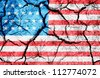 Cracked soil as USA flag - stock photo