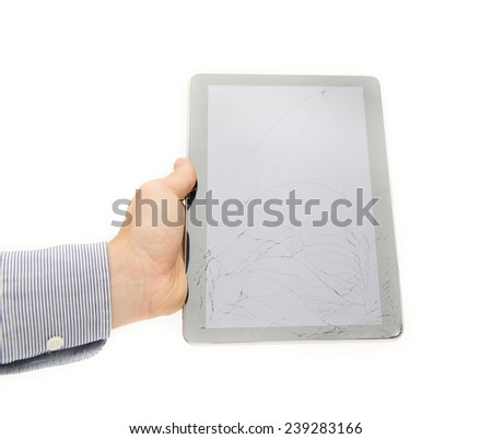 Cracked tablet touch screen display on a white background suggesting the need tu insure and protect your electronic device from dangers like breaking it because they are expensive to fix and repair - stock photo