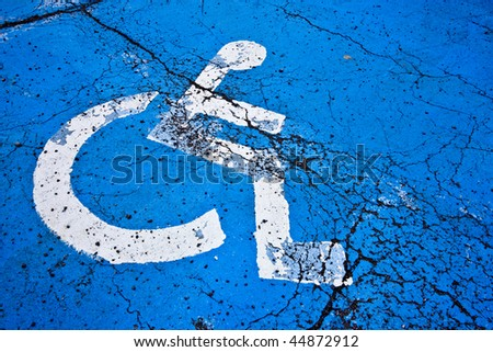 Cracked Texture of a Handicap Parking Space - stock photo