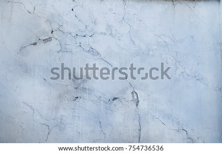 Cracked white concrete wall covered with gray cement surface as background. Grunge wall for vintage background