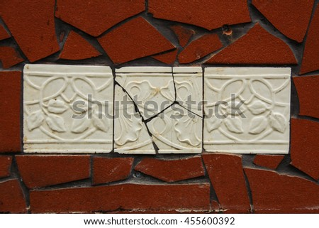 Cracked white tiles with flower pattern - stock photo