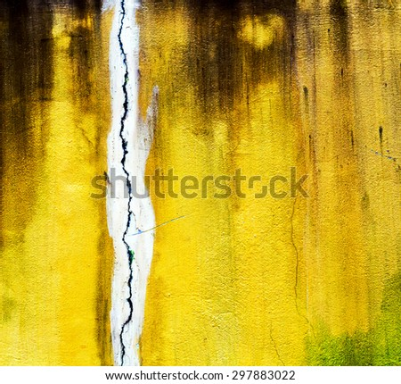 cracked yellow wall stone texture old background - stock photo