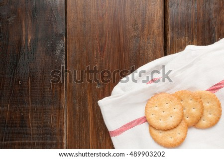cracker stacked on white fabric over wood table
