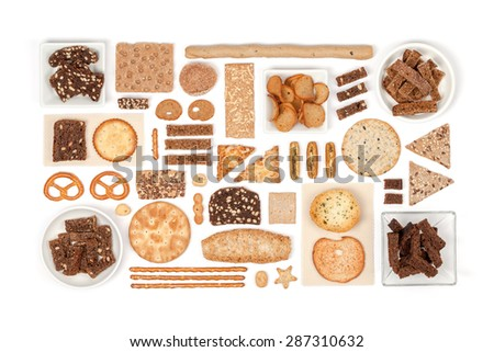 crackers and snacks on white background - stock photo