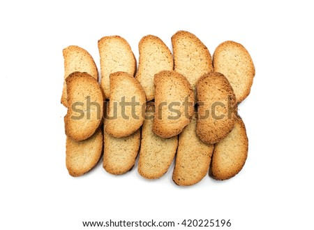 Crackers of bread on a white background. Photo.