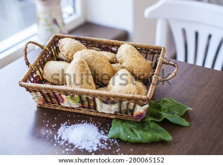 Crackers with cheese, spinach and sea salt - stock photo