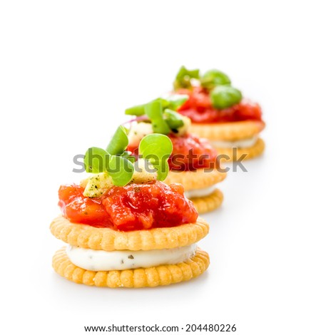 Crackers with salsa, tartar sauce and fresh cress