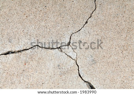Cracking concrete driveway or sidewalk - stock photo