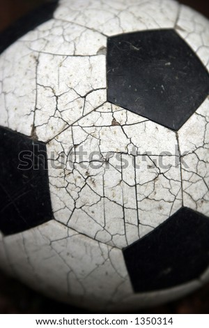Crackled soccer ball. - stock photo