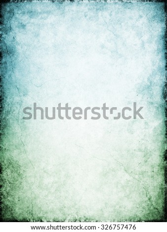 Cracks and stains on a heavily textured vintage paper background.  Image displays a green to blue color gradient.