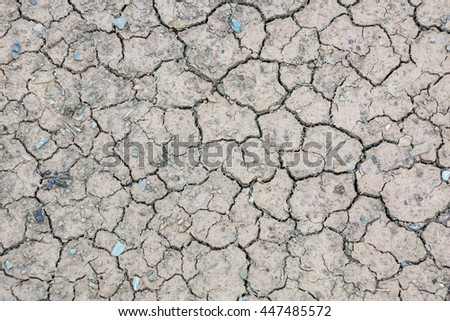 Cracks in the dried soil. - stock photo