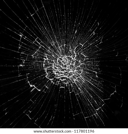 Cracks in the glass on the black background - stock photo