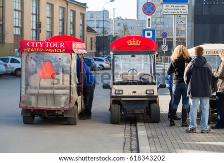 CRACOW, POLAND - FEBRUARY 14, 2016: Guided City Tour Car in Krakow. Poland