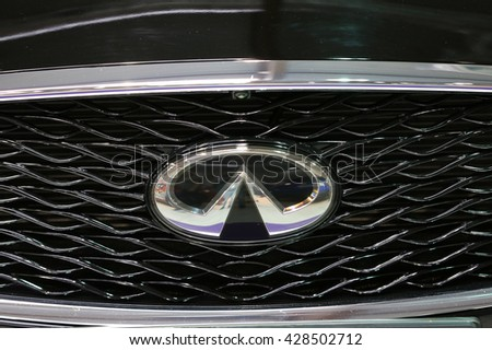CRACOW, POLAND - MAY 21, 2016: Infiniti metallic logo closeup on the Infiniti  car displayed at 3rd edition of MOTO SHOW in Cracow Poland. - stock photo