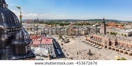 Cracow, Poland panorama. View on the the old town market square and Cloth Hall from the top of the St. Mary's Basilica Tower. - stock photo
