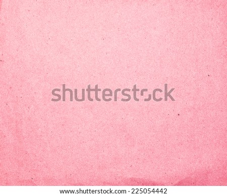 Craft eco textured paper sheet background beige color for cards and other design ideas pink coral color - stock photo