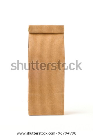 Craft paper pack for lose tea isolated on white - stock photo