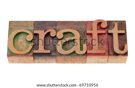 craft word in vintage wooden letterpress printing blocks, stained by color inks, isolated on white