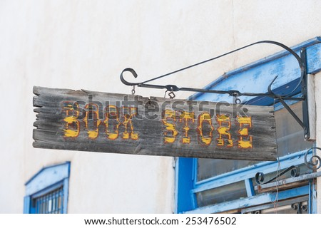 Crafted book store sign in Taos shopping center - stock photo